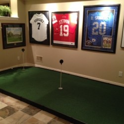 large indoor putting green in golf room