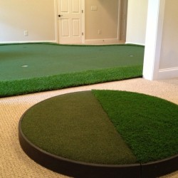 chipping pad next to custom golf green in golf room